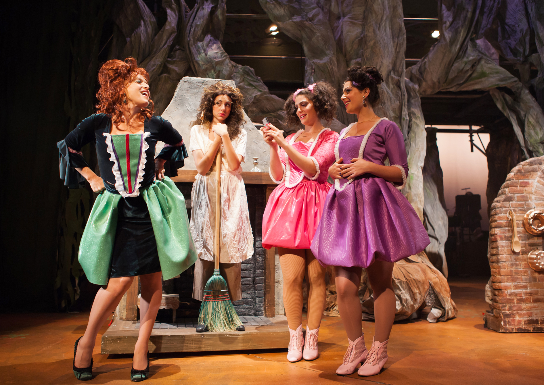 Cinderella's Stepmother (Bekka Fink), taunts Cinderella (Monique Hafen*) about going to the King's Festival while stepsisters Lucinda (Lily Drexler) and Florinda (Michelle Drexler) look on.